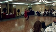 Barbara and Misha dance Rumba at our jacksonville ballroom dance studio summer case