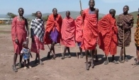 Funny Maasai baby trying to dance with the morans