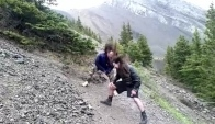 Headbanging while hiking down a mountain