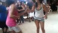 Two girls dance Merengue Guajira