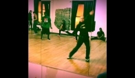 Zumba Fitness Instructor Whacking Waacking at Dance Session