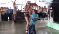 Boy dancing Merengue on party